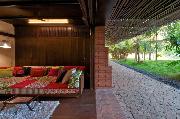 Image of: Colorful-Large-Sofas Rustic Home Design Called Brick Kiln House Design in Small Village Munavali, India