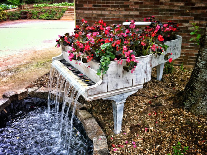 Image of: Old Piano Turned into an Outdoor Water Fountain