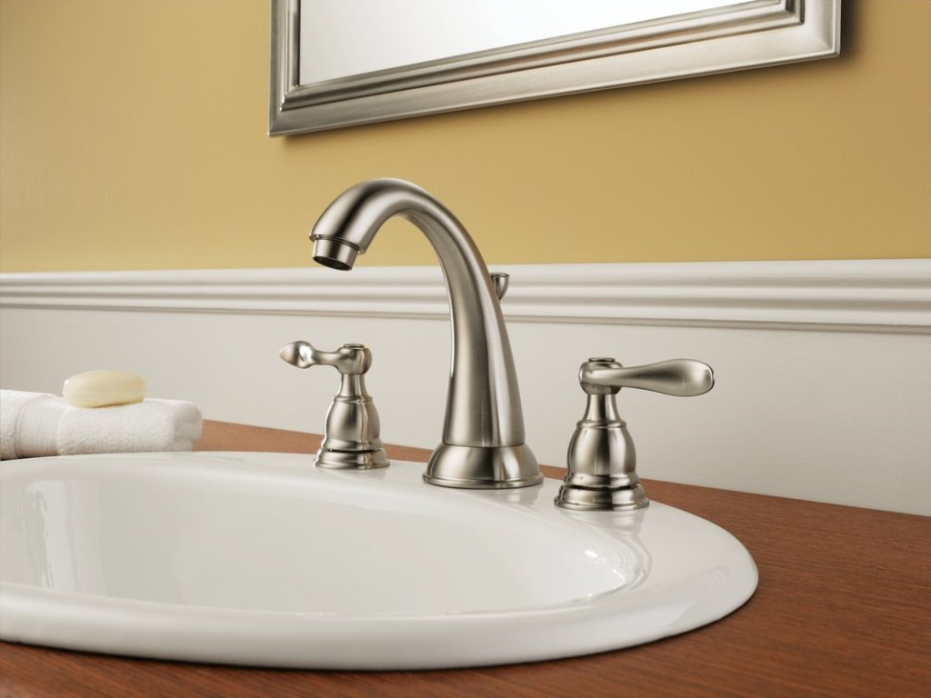 Image of: Chrome And Gold Bathroom Faucets