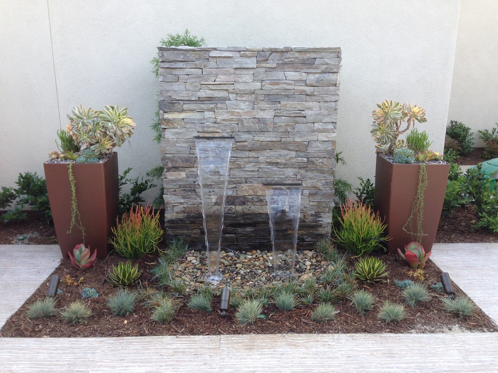 Image of: Backyard Water Fountains Wall Stones