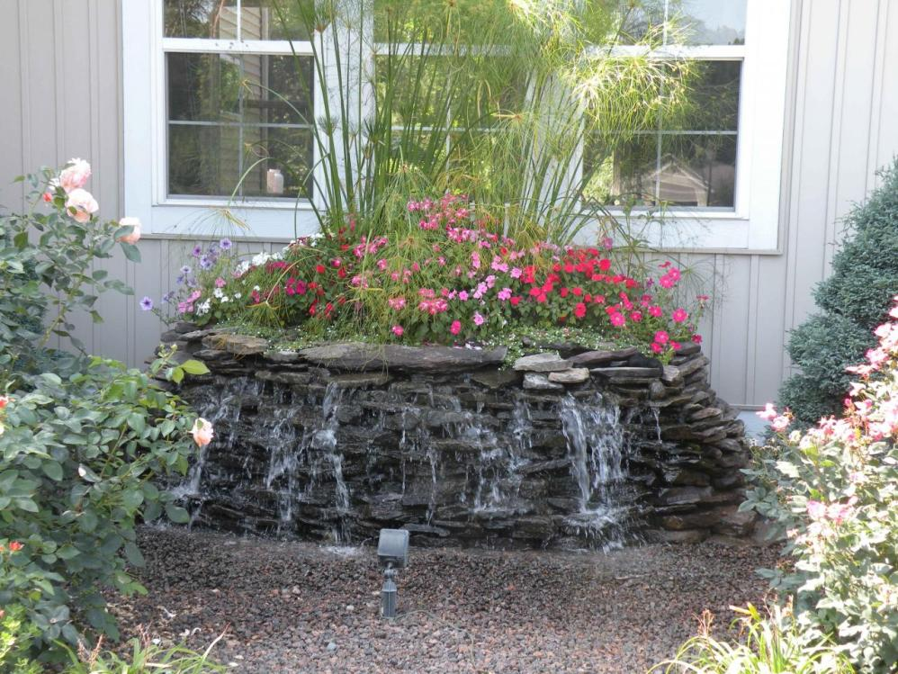 Image of: Backyard Water Fountains with Flowers