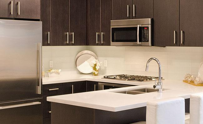 Image of: white tile backsplash with dark cabinets