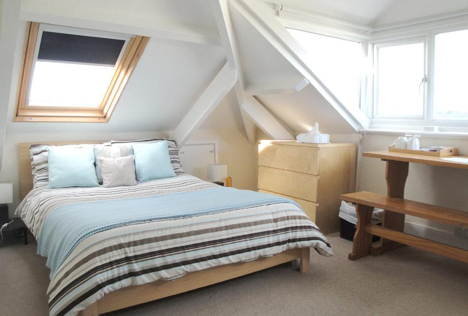 Image of: How To Decorate A Large Attic Bedroom